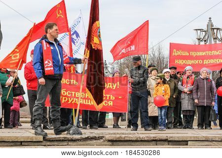 Kirishi, Russia - 1 May, People with festive flags and banners,1 May, 2017. People at the May demonstration and rally in the Russian provincial government.