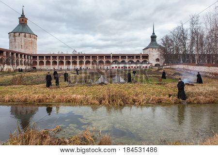 Kirillov Vologda region Russia - Nov 16 2010: Monks work in the garden in the Kirillo-Belozersky monastery