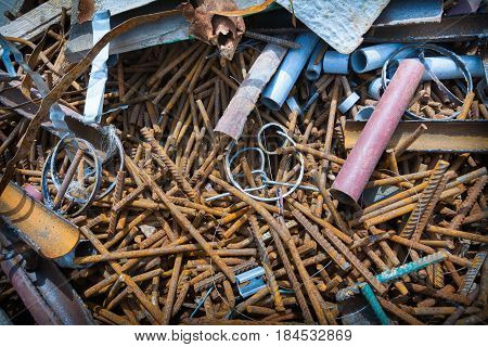 Construction site. Remains of building materials. Rusted fittings, plastic pipes, pieces of metal, wires.