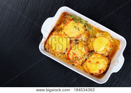 Meat Chops Layered With Vegetables And Cheese