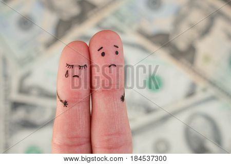 Fingers art of displeased couple on background of money. Concept of poor people.