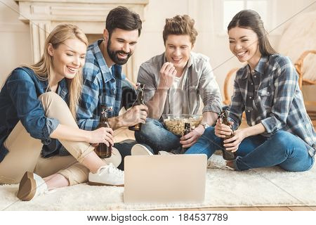 Two Couples Watching Movie On Laptop