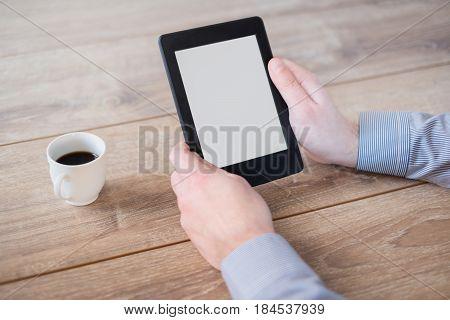 Man Holding An E-book Reader In Hands