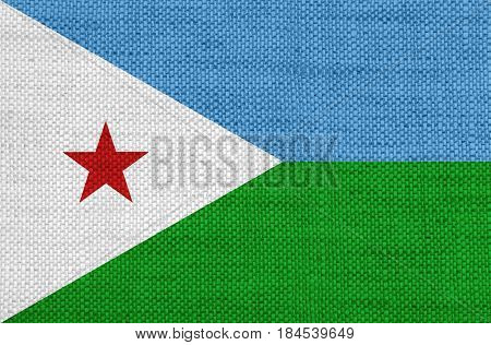 Colorful and crisp image of flag of Djibouti on old linen