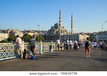 A Fishemen On Galata Bridge In Front Of New Mosque In Istanbul