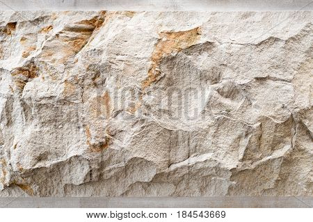 Stone background, sand wall pattern texture. Yellow natural stone facade, wall tile