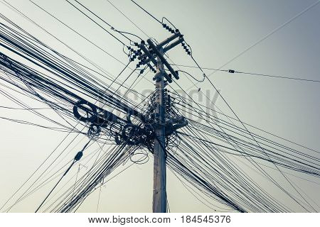 Mess Of Wire And Cable Clutter On Electric Pole