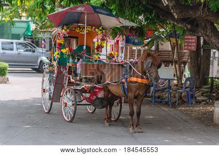 LAMPANG THAILAND - 23 APRIL 2017: Kelang Nakorn Lampang transport signature. Lampang last province in Thailand service horse carriage for travel around the city impression for travel tourist.