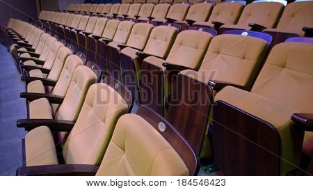 Several rows of folding comfortable padded seats in the theater