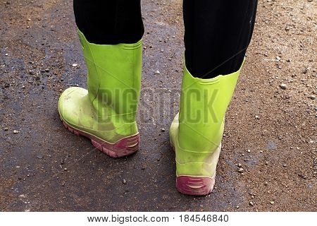 green color rubber dirty boots countryside  ground