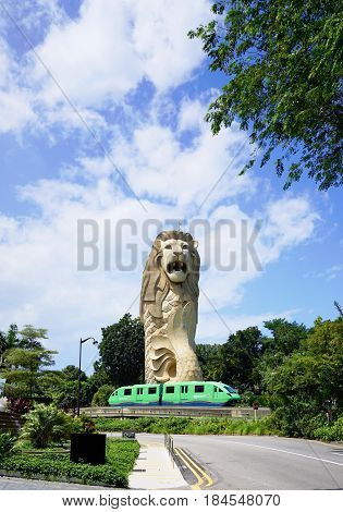 Singapore, Singapore - February 13, 2017: Sentosa express train move alongside the Merlion statue on the Sentosa Island near bay in Singapore.