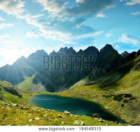 Mountain ridge Bast with lake Hincovo pleso at sunset. Mengusovska Valley in Vysoke Tatry (High Tatras), Slovakia