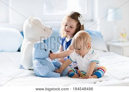 Kids Playing On Parents Bed