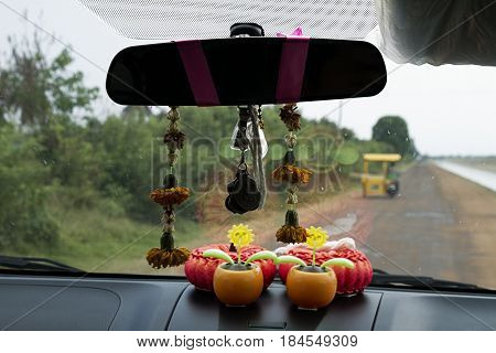 inside car traditional spirit protection offer , belief