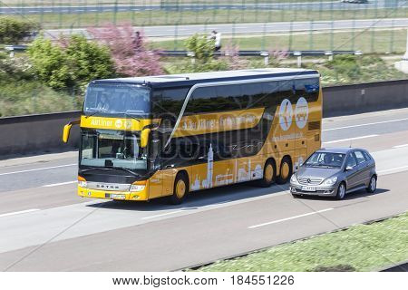 Frankfurt Germany - March 30 2017: Yellow Airliner bus on the highway near Frankfurt International Airport Germany