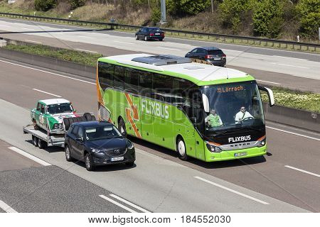 Fraknfurt Germany - March 30 2017: Flixbus coach on the autobahn. Flixbus is an european long distance coach service
