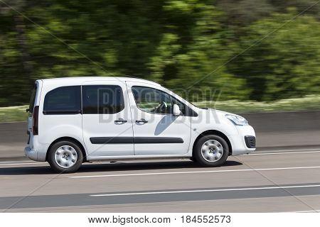 Frankfurt Germany - March 30 2017: White Citroen Berlingo van driving on the highway in Germany