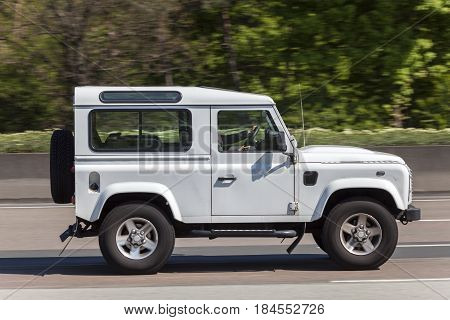 Frankfurt Germany - March 30 2017: Land Rover Defender 90 driving on the highway in Germany