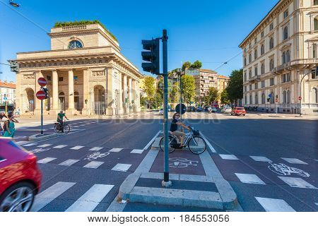 MILAN ITALY - September 06 2016: Bicyclistsare are waiting the green light of traffic light on the crossroad on Avenue Buenos Aires (Corso Buenos Aires) and street Bastioni di Porta Venezia where there is a bicycle lane for bicyclists
