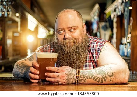 Ooh, this appetizing drink. Outgoing bearded male expressing wish to degust glass of beer