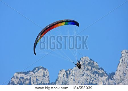 Paraglider flying wing in the French Alps
