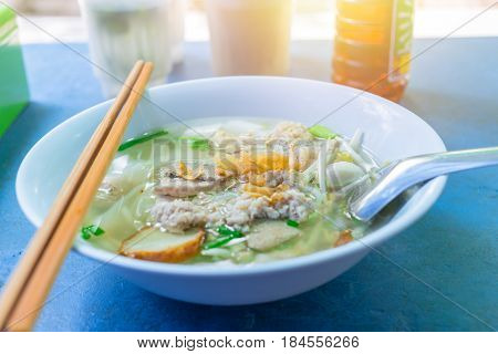 Thai Chinese style noodle with beansprout. Street food lunch in Thailand.
