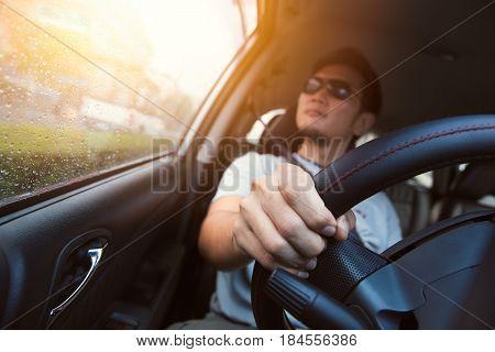 Asian Man Male Ware Sun Glass Drive A Car.
