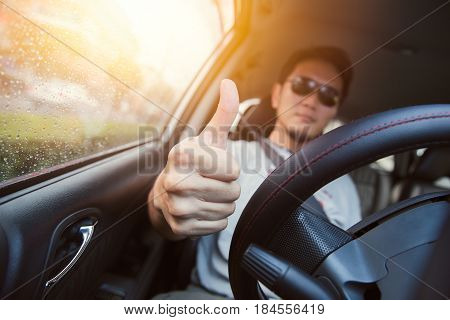 Good Drive Thumb Up Concept. Asian Man Male Ware Sun Glass Drive A Car.