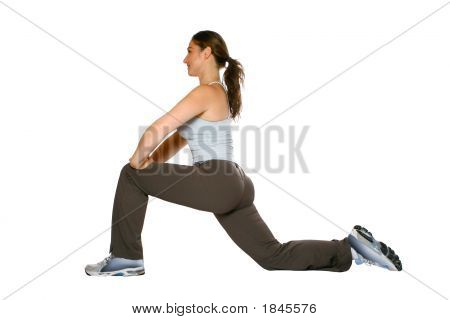 135Fitness Trainer Doing Stretching Exercise For Thigh Muscle Isolated On White