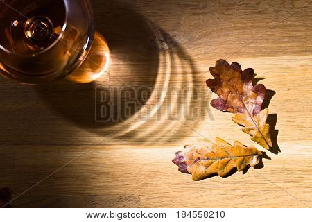 Snifter Of Brandy And Dried Oak Leaves