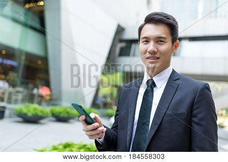 Asian Businessman holding cellphone