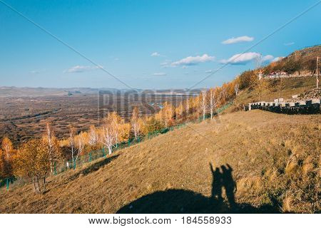 On A Moutain Of Inner Mongolia Hulun Buir River Genhe Wetland In Eergu'na,in Autumn With Yellow Tree