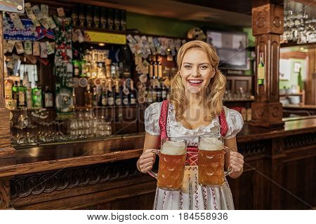 Portrait of young female showing cheerfulness while serving alcohol in pub
