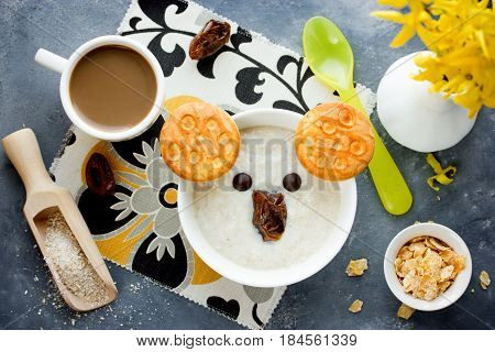 Oat bran porridge with cookies chocolate and dates shaped cute koala face for healthy breakfast top view
