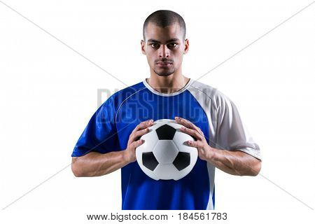 Portrait of football player holding football with both hands against white background