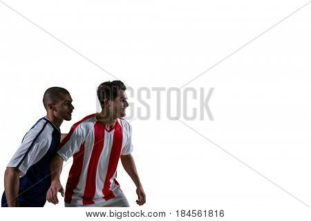 Two football players defending each other while playing soccer against white background