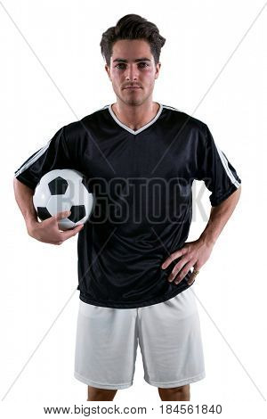 Football player holding a football against white background