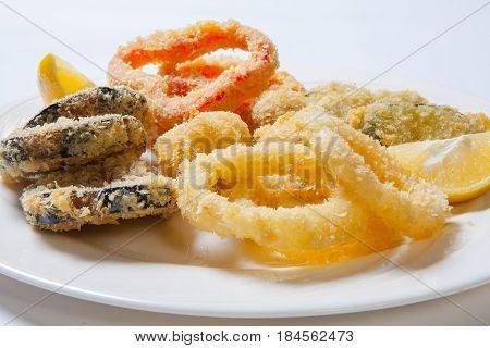 Vegetables In Batter. Onion Rings, Pepper Eggplant Zucchini And Lemon