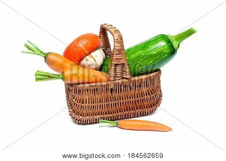Basket with vegetables on a white background. Horizontal photo.