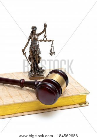 statue of justice gavel and book on a white background. vertical photo.