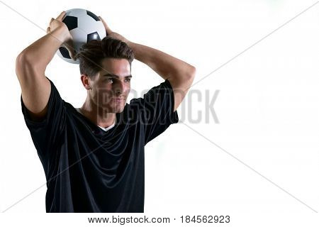 Football player about to throw the football against white background