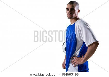 Portrait of football player holding a football against white background