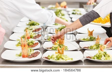 Cooks Are Garnishing Appetizer Dishes