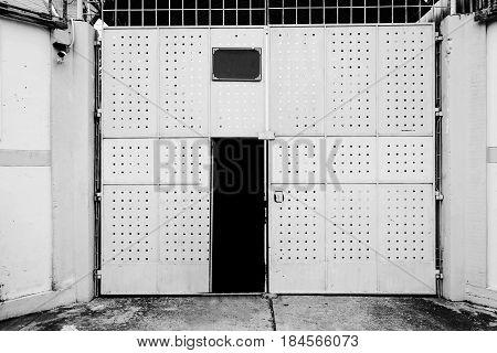 scary rusty metal door with door locked attached in white tone