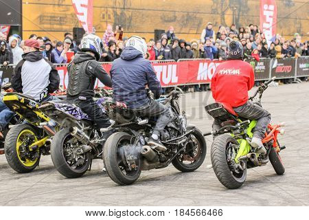 St. Petersburg Russia - 15 April, A number of athletes before the start,15 April, 2017. International Motor Show IMIS-2017 in Expoforurum. Sports motorcycle show of bikers on the open area.