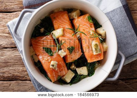 Salmon Baked With Spinach And Roquefort Cheese Close-up. Horizontal Top View