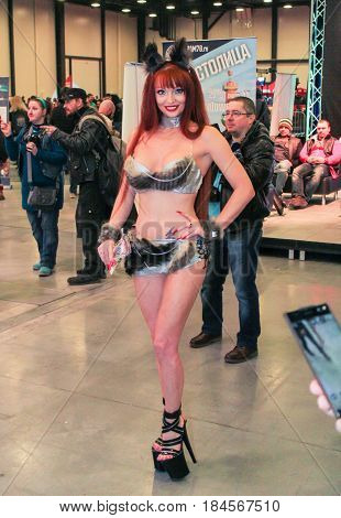 St. Petersburg Russia - 15 April, A fashion model in a fluffy bikini,15 April, 2017. International Motor Show IMIS-2017 in Expoforurum. Models on motorcycles presented at the motor show.