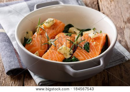 Delicatessen Food: Salmon Baked With Spinach, Rosemary And Roquefort Cheese Close-up. Horizontal