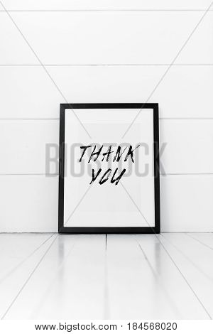 Blank frame on a white background with quotation. Thank you.