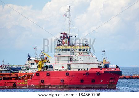 Labuan,Malaysia-June 17,2016:Multi function offshore support vessel at port of Labuan,Malaysia.All the vessels port in Labuan island,most related to the offshore Oil & Gas industry